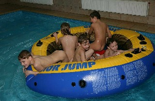 family naturists in pool